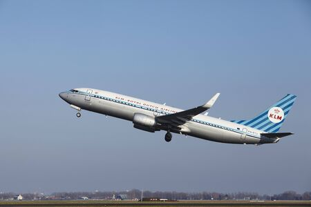 livery: The KLM Boeing 737-8K2 (Retro livery) with identification PH-BXA takes off at Amsterdam Airport Schiphol (The Netherlands, AMS), Polderbaan on March 13, 2016.