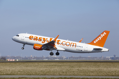 polderbaan: The EasyJet Airbus A320-214 with identification G-EZOB takes off at Amsterdam Airport Schiphol (The Netherlands, AMS), Polderbaan on March 13, 2016. Editorial