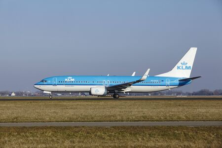 polderbaan: The KLM Boeing 737-8K2 with identification PH-BCE takes off at Amsterdam Airport Schiphol (The Netherlands, AMS), Polderbaan on March 13, 2016.