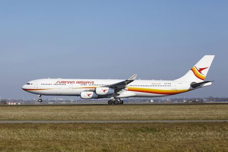 polderbaan: The Surinam Airways Airbus A340-313 with identification PZ-TCR takes off at Amsterdam Airport Schiphol (The Netherlands, AMS), Polderbaan on March 13, 2016. Editorial