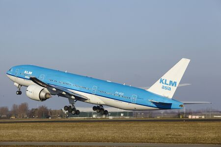 polderbaan: The KLM Boeing 777-206(ER) (KLM Asia livery) with identification PH-BQK takes off at Amsterdam Airport Schiphol (The Netherlands, AMS), Polderbaan on March 13, 2016.