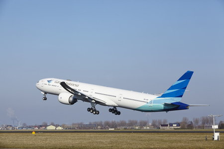 polderbaan: The Garuda Indonesia Boeing 777-3U3(ER) with identification PK-GIC takes off at Amsterdam Airport Schiphol (The Netherlands, AMS), Polderbaan on March 13, 2016. Editorial