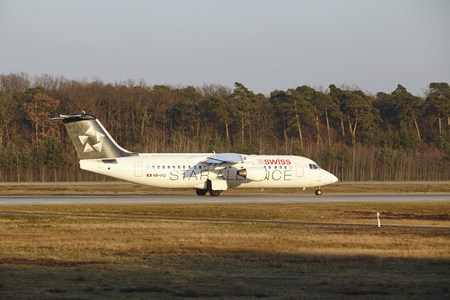 jetliner: The Swiss Airline Avro RJ100 (Star Alliance livery) with identification HB-IYU takes off at Frankfurt International Airport (Germany, FRA) on March 18, 2016.