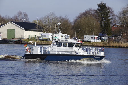 schleswig holstein: The police boat Vossbrook at the Kiel Canal near Hochdonn (Germany, Schleswig Holstein) on April 2, 2016. Editorial