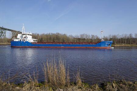 schleswig holstein: The general cargo vessel Fehn Caledonia at the Kiel Canal near Hochdonn (Germany, Schleswig Holstein) on April 2, 2016.