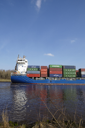 sued: The container vessel Morsum at the Kiel Canal near Hochdonn (Germany, Schleswig Holstein) on April 2, 2016.