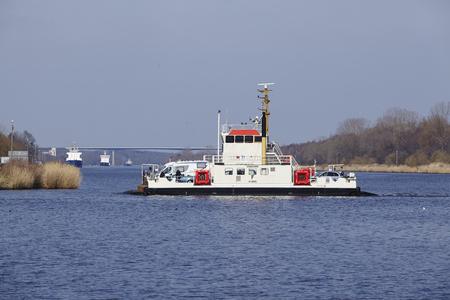 schleswig holstein: The ferry boat Hochdonn at the Kiel Canal near Hochdonn (Germany, Schleswig Holstein) on April 2, 2016.