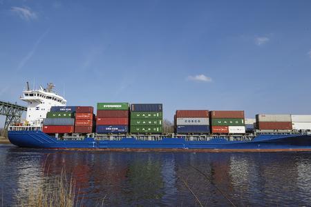 schleswig holstein: The container vessel Morsum at the Kiel Canal near Hochdonn (Germany, Schleswig Holstein) on April 2, 2016.