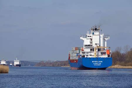 schleswig holstein: The container vessel Wybelsum at the Kiel Canal near Hochdonn (Germany, Schleswig Holstein) on April 2, 2016. Editorial