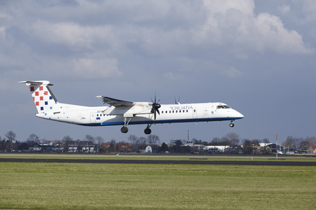 The Croatia Airlines Bombardier Dash 8 Q400 with identification 9A-CQD lands at Amsterdam Airport Schiphol (The Netherlands, AMS), Polderbaan on April 8, 2016.