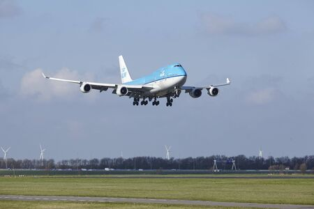 alight: The KLM Boeing 747-406(M) with identification PH-BFW lands at Amsterdam Airport Schiphol (The Netherlands, AMS), Polderbaan on April 8, 2016.