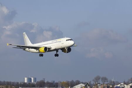 polderbaan: The Vueling Airbus A320-214 with identification EC-KDH lands at Amsterdam Airport Schiphol (The Netherlands, AMS), Polderbaan on April 8, 2016.