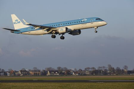 polderbaan: The KLM Cityhopper Embraer ERJ-190STD with identification PH-EZR lands at Amsterdam Airport Schiphol (The Netherlands, AMS), Polderbaan on April 8, 2016.