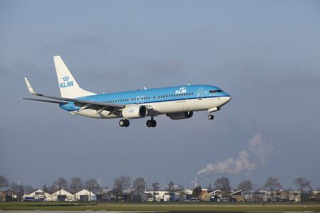 alight: The KLM Boeing 737-8K2 with identification PH-BXK lands at Amsterdam Airport Schiphol (The Netherlands, AMS), Polderbaan on April 8, 2016.