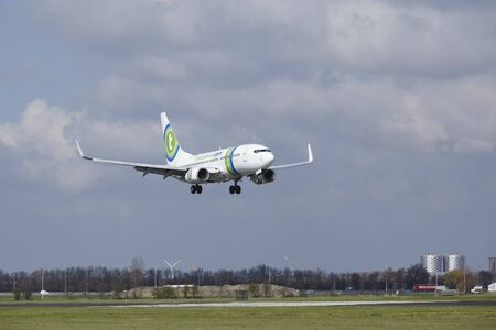 alight: The Transavia Boeing 737-7K2 with identification PH-XRA lands at Amsterdam Airport Schiphol (The Netherlands, AMS), Polderbaan on April 8, 2016. Editorial