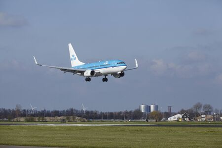 polderbaan: The KLM Boeing 737-7K2 with identification PH-BGQ lands at Amsterdam Airport Schiphol (The Netherlands, AMS), Polderbaan on April 8, 2016. Editorial