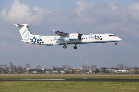 alight: The Flybe Bombardier Dash 8 Q400 with identification G-ECOC lands at Amsterdam Airport Schiphol (The Netherlands, AMS), Polderbaan on April 8, 2016.