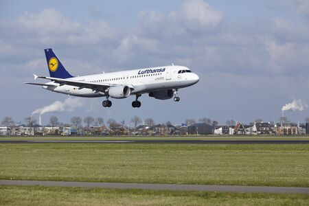 The Lufthansa Airbus A320-214 with identification D-AIZD lands at Amsterdam Airport Schiphol (The Netherlands, AMS), Polderbaan on April 8, 2016.