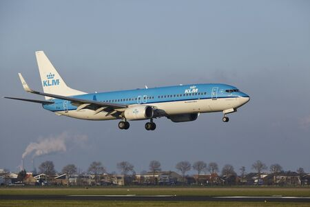 polderbaan: The KLM Boeing 737-8K2 with identification PH-BXM lands at Amsterdam Airport Schiphol (The Netherlands, AMS), Polderbaan on April 8, 2016.