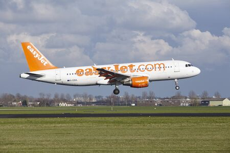 air traffic: The Easyjet Airbus A320-214 with identification G-EZUL lands at Amsterdam Airport Schiphol (The Netherlands, AMS), Polderbaan on April 8, 2016.