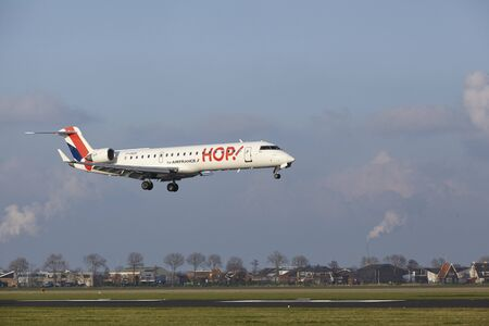 polderbaan: The HOP! Bombardier CRJ-701 with identification F-GRZG lands at Amsterdam Airport Schiphol (The Netherlands, AMS), Polderbaan on April 8, 2016.
