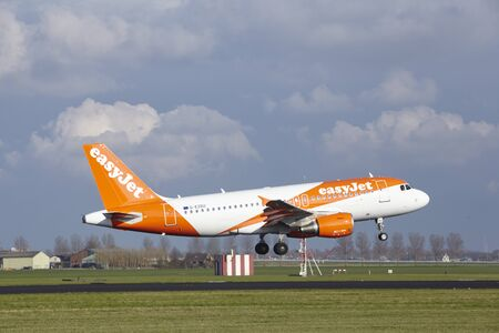 polderbaan: The Easyjet Airbus A319-111 with identification G-EZDU lands at Amsterdam Airport Schiphol (The Netherlands, AMS), Polderbaan on April 8, 2016.