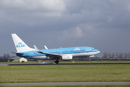The KLM Boeing 737-7K2 with identification PH-BGM lands at Amsterdam Airport Schiphol (The Netherlands, AMS), Polderbaan on April 8, 2016.