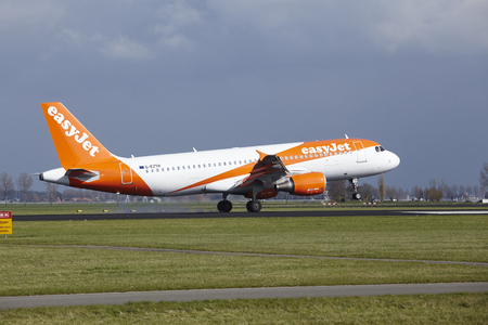polderbaan: The Easyjet Airbus A320-214 with identification G-EZTH lands at Amsterdam Airport Schiphol (The Netherlands, AMS), Polderbaan on April 8, 2016.