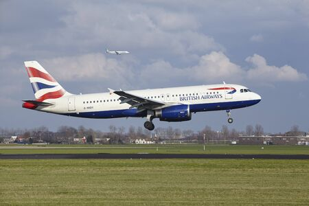 alight: The British Airways Airbus A320-232 with identification G-MIDY lands at Amsterdam Airport Schiphol (The Netherlands, AMS), Polderbaan on April 8, 2016.
