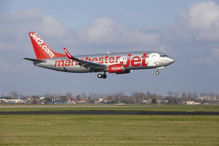 polderbaan: The Jet2 (Manchester Livery) Boeing 737-330 with identification G-CELI lands at Amsterdam Airport Schiphol (The Netherlands, AMS), Polderbaan on April 8, 2016.