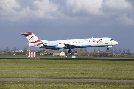 alight: The Austrian Airlines Fokker 100 with identification OE-LVM lands at Amsterdam Airport Schiphol (The Netherlands, AMS), Polderbaan on April 8, 2016. Editorial