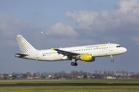 The Vueling Airbus A320-214 with identification EC-KDH lands at Amsterdam Airport Schiphol (The Netherlands, AMS), Polderbaan on April 8, 2016.