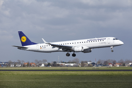 The Lufthansa CityLine Embraer ERJ-195LR with identification D-AEBH lands at Amsterdam Airport Schiphol (The Netherlands, AMS), Polderbaan on April 8, 2016.