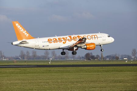 The Easyjet Airbus A320-214 with identification G-EZWD lands at Amsterdam Airport Schiphol (The Netherlands, AMS), Polderbaan on April 8, 2016.