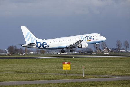 alight: The Flybe Embraer ERJ-175STD with identification G-FBJA lands at Amsterdam Airport Schiphol (The Netherlands, AMS), Polderbaan on April 8, 2016.