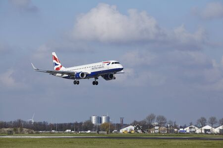alight: The British Airways (BA CityFlyer) Embraer ERJ-190SR with identification G-LCYO lands at Amsterdam Airport Schiphol (The Netherlands, AMS), Polderbaan on April 8, 2016.