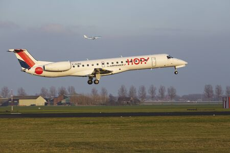 The HOP! Embraer ERJ-145MP with identification F-GUBG lands at Amsterdam Airport Schiphol (The Netherlands, AMS), Polderbaan on April 8, 2016.