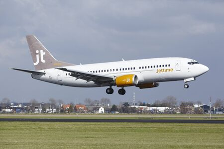 polderbaan: The Jettime Boeing 737-382(QC) with identification OY-JTF lands at Amsterdam Airport Schiphol (The Netherlands, AMS), Polderbaan on April 8, 2016.