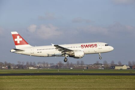 alight: The SWISS Airbus A320-214 with identification HB-IJR lands at Amsterdam Airport Schiphol (The Netherlands, AMS), Polderbaan on April 8, 2016. Editorial