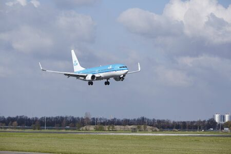 The KLM Boeing 737-8K2 with identification PH-BXE lands at Amsterdam Airport Schiphol (The Netherlands, AMS), Polderbaan on April 8, 2016. Editorial