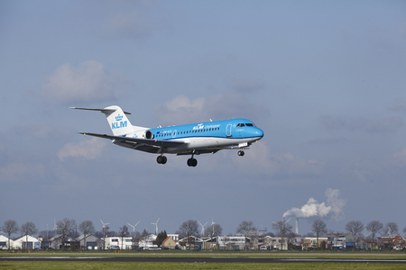 polderbaan: The KLM Cityhopper Fokker 70 with identification PH-KZL lands at Amsterdam Airport Schiphol (The Netherlands, AMS), Polderbaan on April 8, 2016. Editorial
