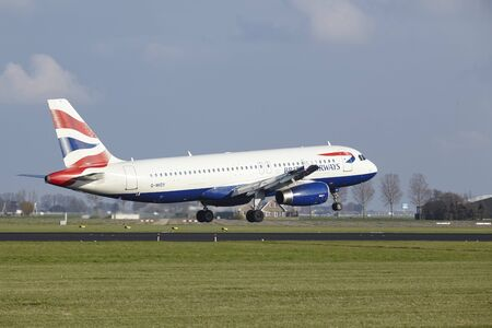 The British Airways Airbus A320-232 with identification G-MIDY lands at Amsterdam Airport Schiphol (The Netherlands, AMS), Polderbaan on April 8, 2016.