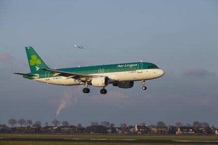 The Air Lingus Airbus A320-214 with identification EI-DEB lands at Amsterdam Airport Schiphol (The Netherlands, AMS), Polderbaan on April 8, 2016. Editorial