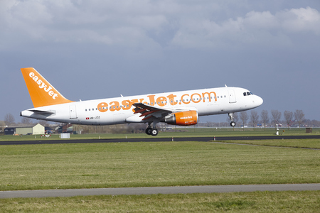 The Easyjet Switzerland Airbus A320-214 with identification HB-JZZ lands at Amsterdam Airport Schiphol (The Netherlands, AMS), Polderbaan on April 8, 2016.