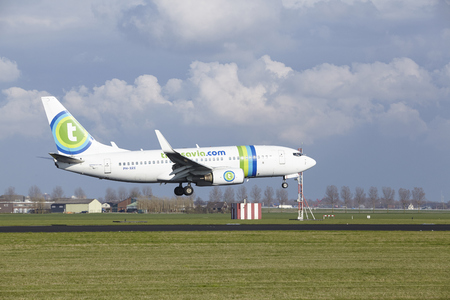 The Transavia Boeing 737-7K2 with identification PH-XRX lands at Amsterdam Airport Schiphol (The Netherlands, AMS), Polderbaan on April 8, 2016.