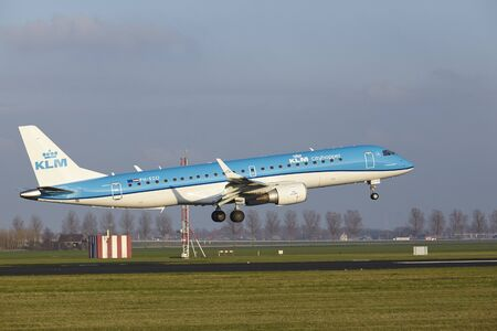 The KLM Cityhopper Embraer ERJ-190STD with identification PH-EZO lands at Amsterdam Airport Schiphol (The Netherlands, AMS), Polderbaan on April 8, 2016.