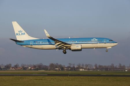The KLM Boeing 737-8BK with identification PH-BXU lands at Amsterdam Airport Schiphol (The Netherlands, AMS), Polderbaan on April 8, 2016.