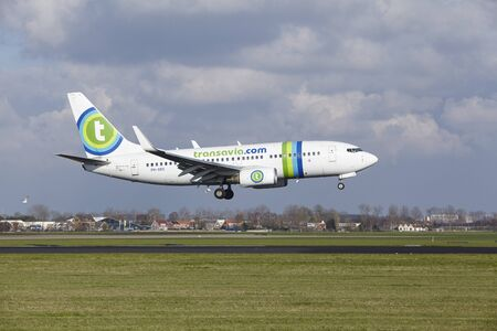 polderbaan: The Transavia Boeing 737-7K2 with identification PH-XRX lands at Amsterdam Airport Schiphol (The Netherlands, AMS), Polderbaan on April 8, 2016.