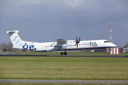The Flybe Bombardier Dash 8 Q400 with identification G-JECL lands at Amsterdam Airport Schiphol (The Netherlands, AMS), Polderbaan on April 8, 2016.