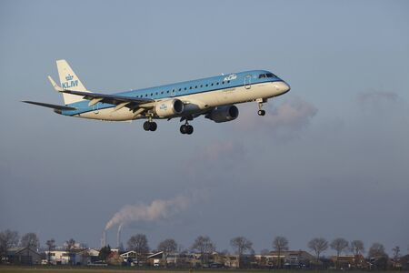 The KLM Cityhopper Embraer ERJ-190STD with identification PH-EZR lands at Amsterdam Airport Schiphol (The Netherlands, AMS), Polderbaan on April 8, 2016.